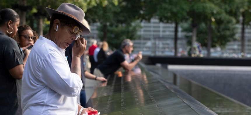 People mourn near the National September 11 Memorial in New York in September, 2019.