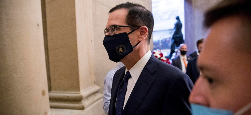 Treasury Secretary Steven Mnuchin walks into a meeting on Capitol Hill on July 29. Some say the terms of the USPS loan, signed by Mnuchin, will allow undue political influence over the mailing agency.