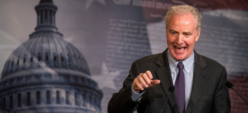 Sen. Chris Van Hollen, D-Md., speaks during a news conference on Capitol Hill in June. Van Hollen is one of the senators advocating extra protections for feds.