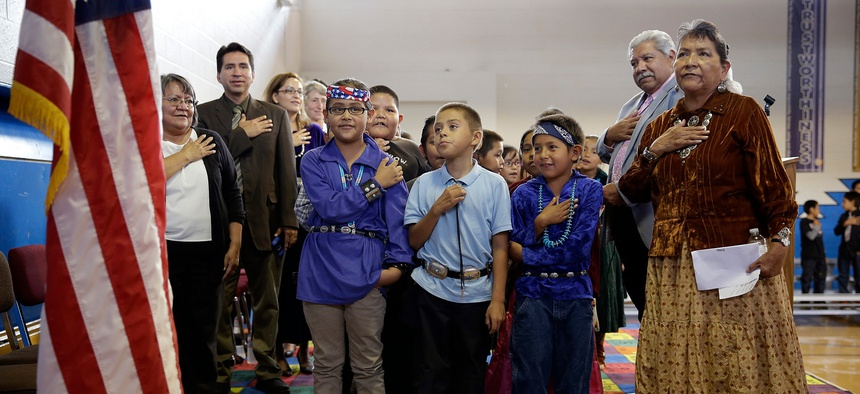 Students and teachers recite the Pledge of Allegiance at Crystal Boarding School in Crystal, New Mexico, on the Navajo Nation in 2014. The school is overseen by the BIE.