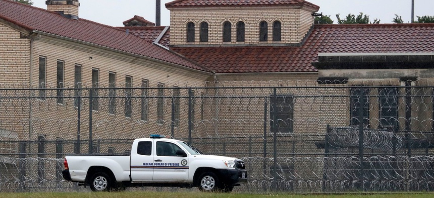 A Federal Bureau of Prisons truck drives past the Federal Medical Center prison in Fort Worth, Texas, in May. The facility had already had hundreds of inmates test positive for COVID-19.