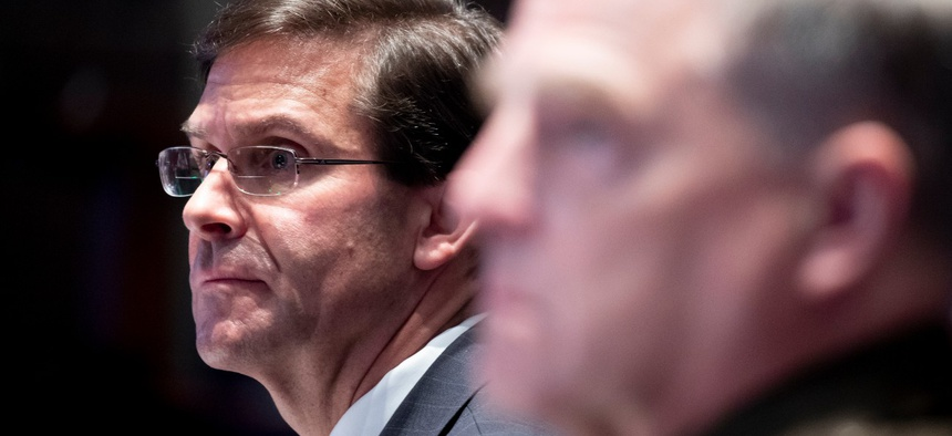 Defense Secretary Mark Esper, left, and Chairman of the Joint Chiefs of Staff Gen. Mark Milley listen during a House Armed Services Committee hearing on July 9.