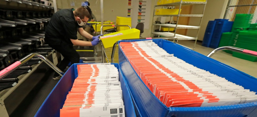 Vote-by-mail ballots are shown in sorting trays at the King County Elections headquarters in Renton, Wash., south of Seattle, on Aug. 5.