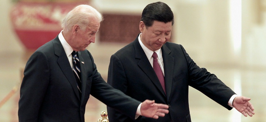 Then-Chinese Vice President Xi Jinping, right, invites his U.S. counterpart Joseph Biden to review an honor guard during a welcoming ceremony inside the Great Hall of the People on Thursday, Aug. 18, 2011 in Beijing.