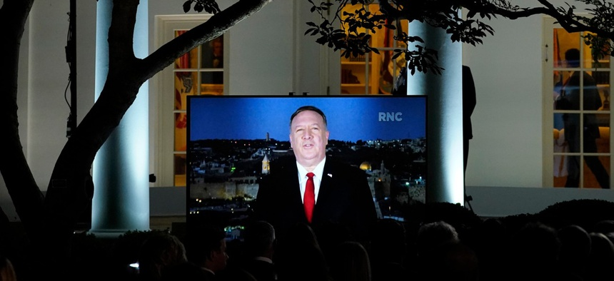 A video of Secretary of State Mike Pompeo speaking during the Republican National Convention plays from the Rose Garden of the White House on Aug. 25.