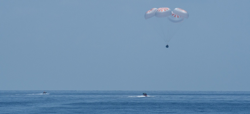 The SpaceX Crew Dragon Endeavour spacecraft lands with NASA astronauts Robert Behnken and Douglas Hurley onboard in the Gulf of Mexico off the coast of Pensacola, Fla., on Aug. 2.