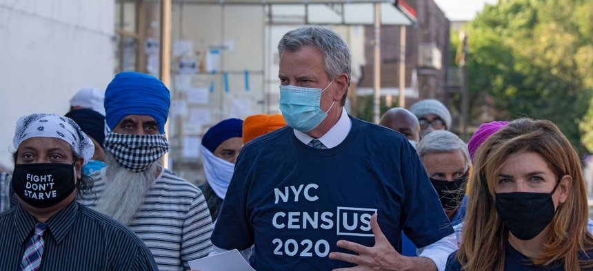 New York City Mayor Bill de Blasio and NYC Census 2020 Director Julie Menin go door-knocking to encourage New Yorkers to complete the census in South Richmond Hill, Queens, on July 29.