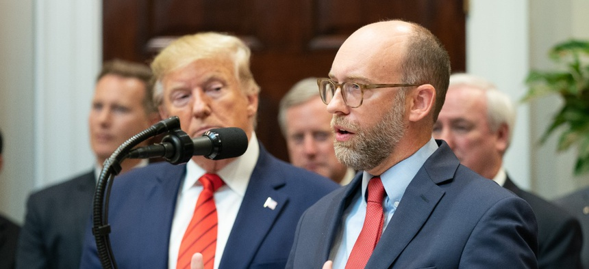 OMB Director Russell Vought, right, claimed that federal agencies make employees attend training sessions that teach critical race theory, an academic framework which studies how racism persists institutionally rather than as personal animus.