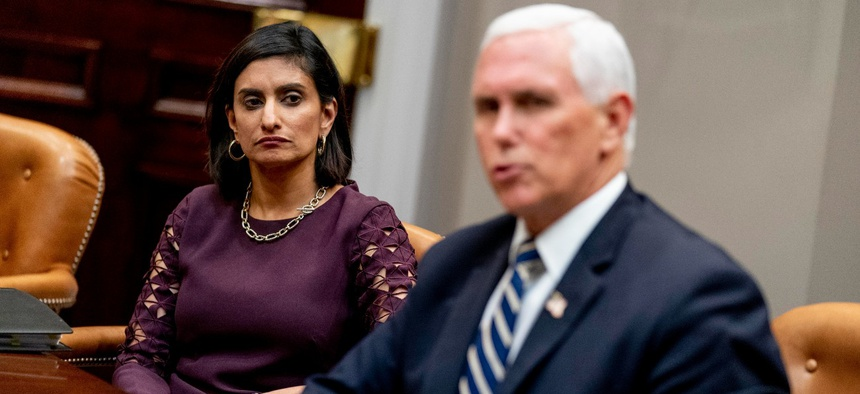 Vice President Mike Pence, right, accompanied by Administrator of the Centers for Medicare and Medicaid Services Seema Verma, left, participates in a meeting on safety and quality for nursing homes on Sept. 17.