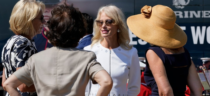 Kellyanne Conway, speaks with Education Secretary Betsy Devos, left, and Transportation Secretary Elaine Chao, second from left, at an event with First Lady Melania Trump, in front of the White House. (