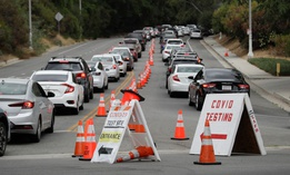 Motorists line up at a coronavirus testing site at Dodger Stadium in Los Angeles in June.