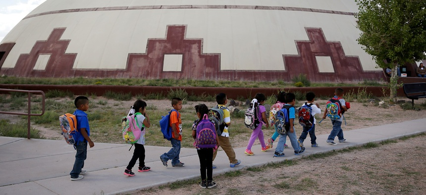 Students walk between buildings at the Little Singer Community School in Birdsprings, Ariz., on the Navajo Nation in 2014.