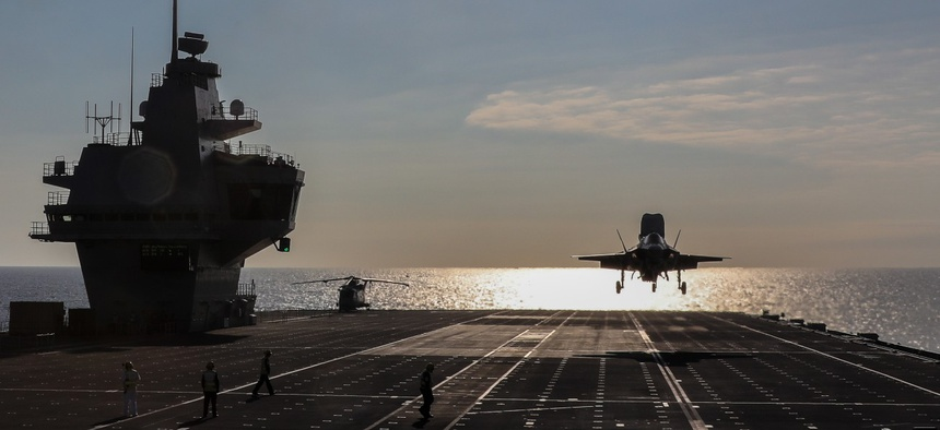 An F-35B Lightning II assigned to the F-35 Integrated Test Force at Naval Air Station Patuxent River, Md., lands aboard the Royal Navy aircraft carrier HMS Queen Elizabeth.
