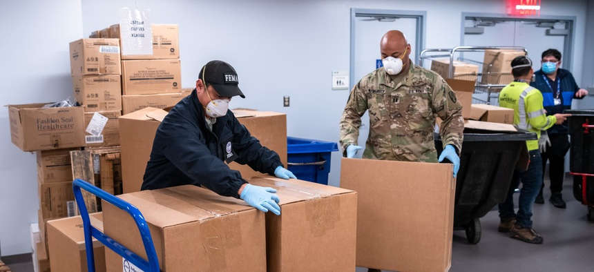Critical N-95 respirators arrive at Bellevue Hospital where FEMA logistics and hospital personnel help unload the delivery in New York in April.