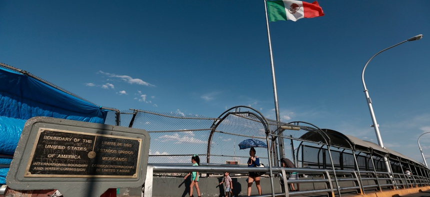 Pedestrians walk to El Paso, Texas, as they cross the Paso del Norte International Bridge, from Ciudad Juarez in 2019.