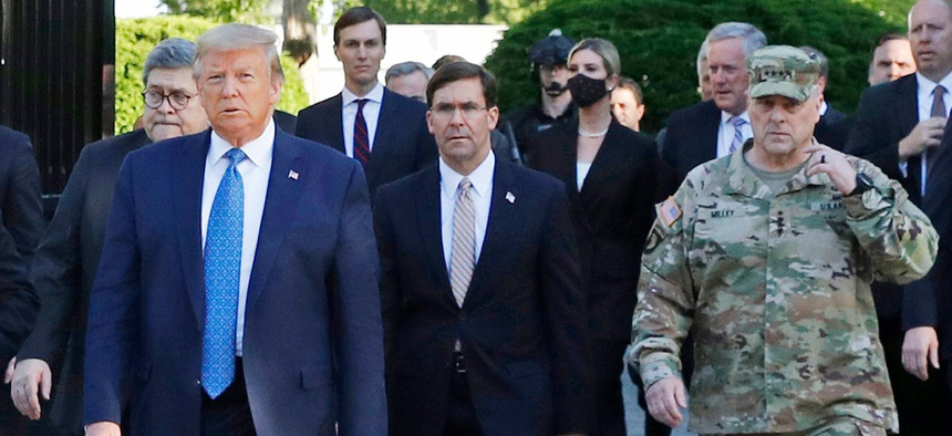 President Trump departs the White House to visit outside St. John's Church in June. Walking behind Trump from left are, Attorney General William Barr, Defense Secretary Mark Esper and Gen. Mark Milley, chairman of the Joint Chiefs of Staff.