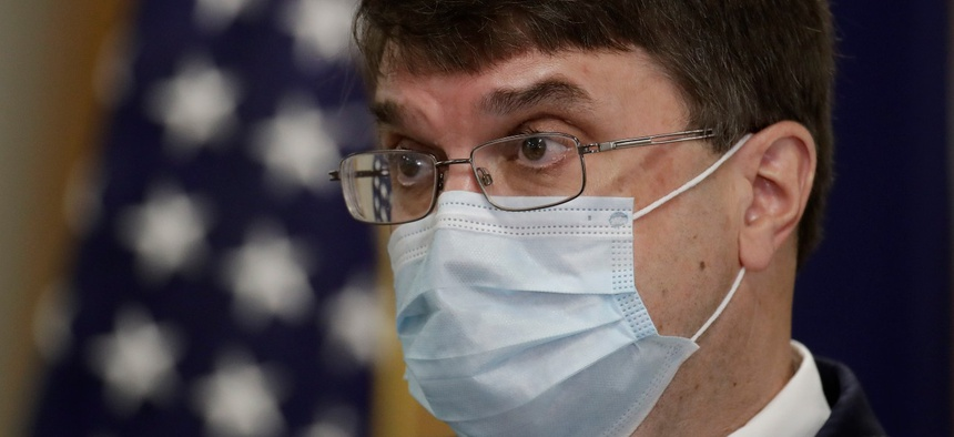 Robert Wilkie, secretary of Veterans Affairs, talks to reporters after touring the Kansas City VA Medical Center in July.