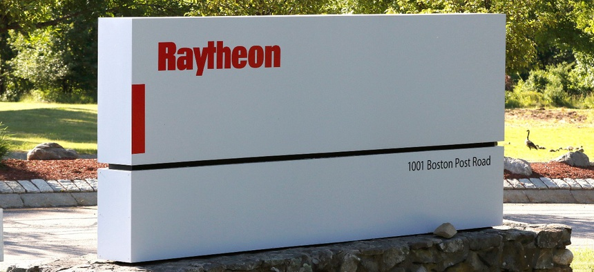 A sign stands at the road leading to the Raytheon facility in Marlborough, Mass.