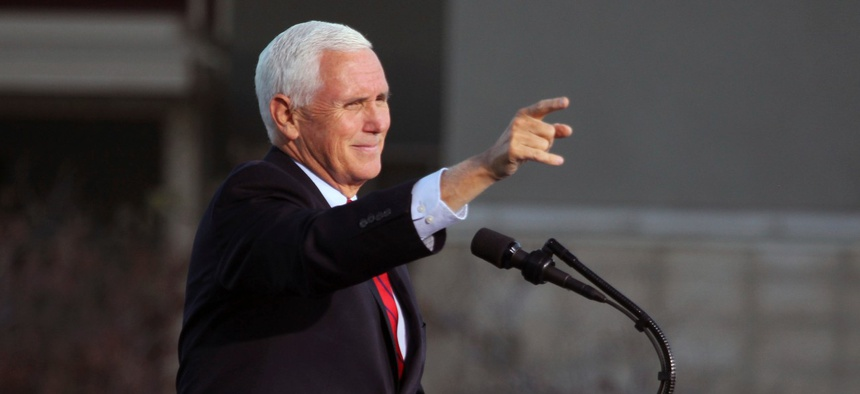 Vice President Mike Pence gestures as he speaks at a campaign rally at Reno-Tahoe International Airport in Reno, Nev., on Thursday.