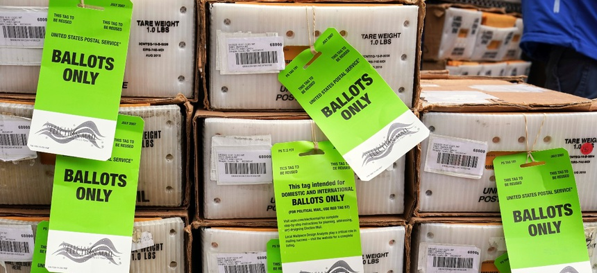Boxes in the first batch of 111,000 mail-in ballots are tagged and ready to ship from the Douglas County Election Commission's office to the post office, in Omaha, Neb., in September.