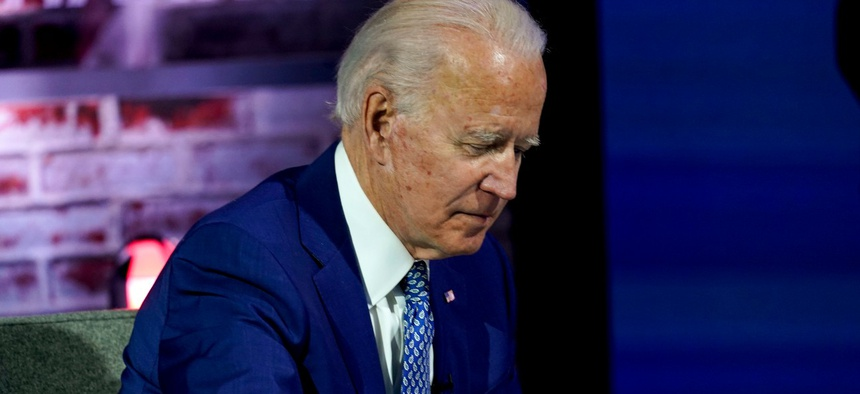 President-elect Joe Biden takes notes during a meeting with his COVID-19 advisory council, Monday, Nov. 9, 2020.
