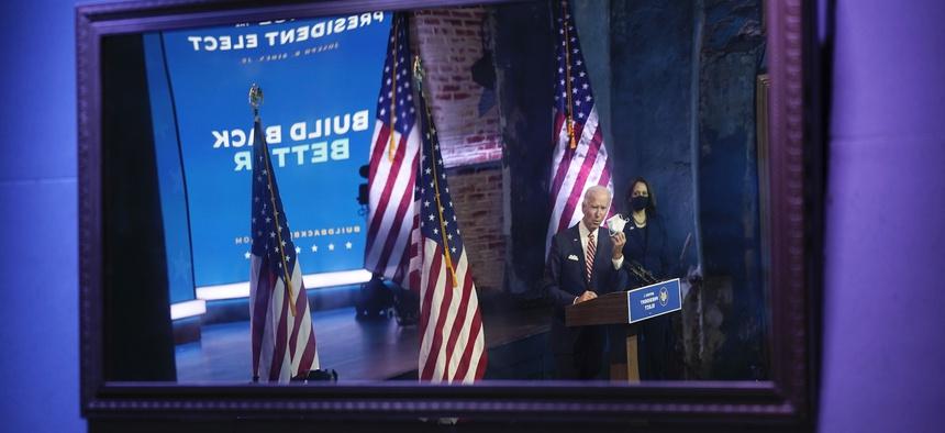 President-elect Joe Biden, accompanied by Vice President-elect Kamala Harris, shown reflected in a mirror, speaks in Delaware on Monday.