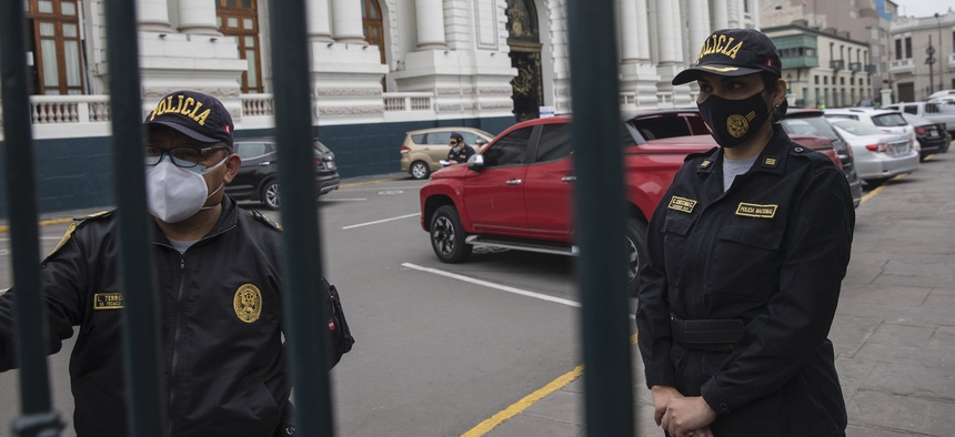 Police stand guard outside Congress in Lima in September.