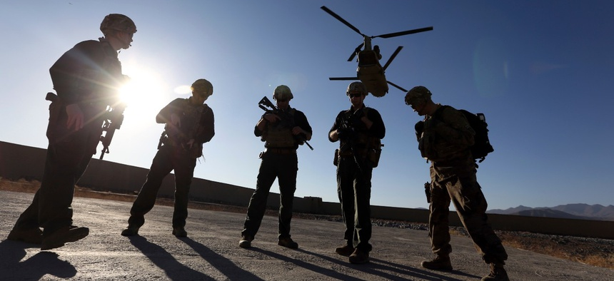American soldiers wait on the tarmac in Logar province, Afghanistan, in 2017.