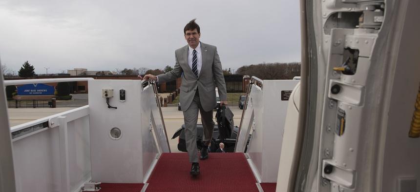 Defense Secretary Mark T. Esper boards a government plane in 2019.