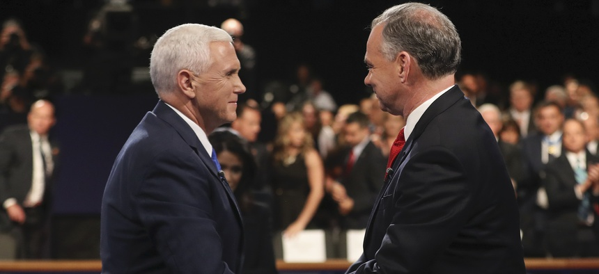 Republican vice-presidential nominee Gov. Mike Pence and Democratic vice-presidential nominee Sen. Tim Kaine shake hands after the vice-presidential debate at Longwood University in Farmville, Va., Tuesday, Oct. 4, 2016.