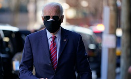 President-elect Joe Biden walks to speak to media as he arrives to meet virtually with the United States Conference of Mayors at The Queen theater Nov. 23 in Wilmington, Del.
