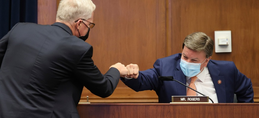 """Now-Defense Secretary Christopher Miller, left, greets committee ranking member Rep. Mike Rogers, R-Ala., before a House Homeland Security Committee hearing on """"worldwide threats to the homeland"""" on Sept. 17."""
