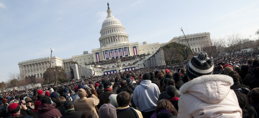The crowd watches Obama's first inaugural in 2009.