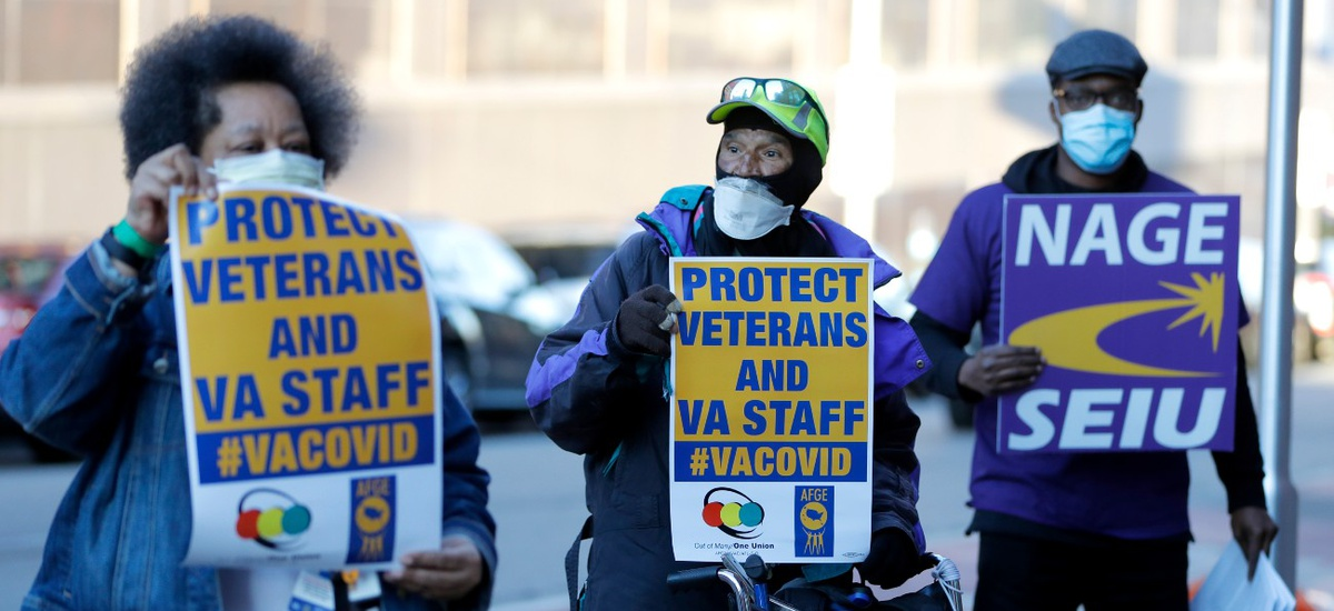 Clarence Shields, center, an Army veteran, pickets with activists from the American Federation of Government Employees local 424 and the National Association of Government Employees local R3-19 outside the Baltimore VA Medical Center in April.