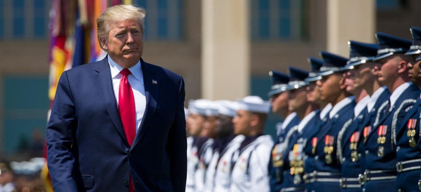 President Trump reviews the troops during a full honors welcoming ceremony for Secretary of Defense Mark Esper at the Pentagon on July 25, 2019.