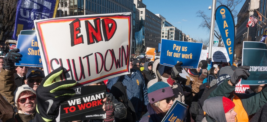 Furloughed as well as unpaid working federal employees, union members, contractors and supporters protest the government shutdown at an AFL-CIO rally Jan. 10, 2019.