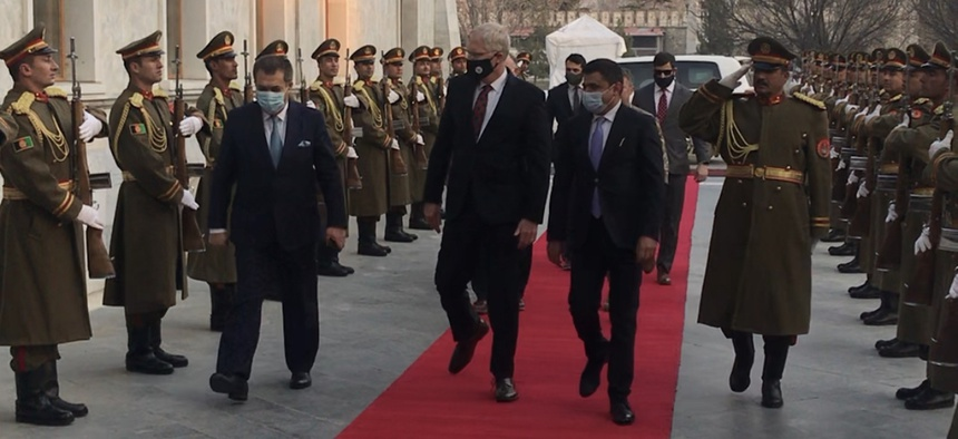 Acting Defense Secretary Christopher Miller enters the Afghanistan Presidential Palace on Tuesday.