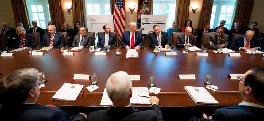 President Trump presides over a Cabinet meeting at the White House in October 2019.