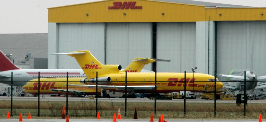 Air cargo planes sit at a DHL air shipping hub in Wilmington, Ohio.
