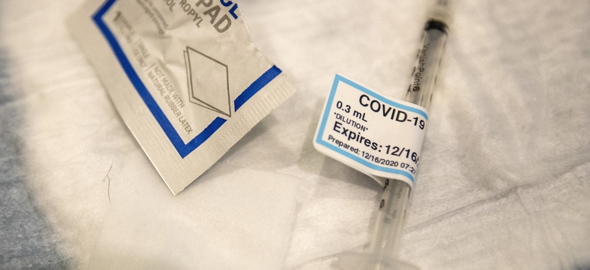 An empty syringe is shown on a table at Ronald Reagan UCLA Medical Center after a care worker received the COVID-19 vaccine on Dec. 16 in Westwood, California.