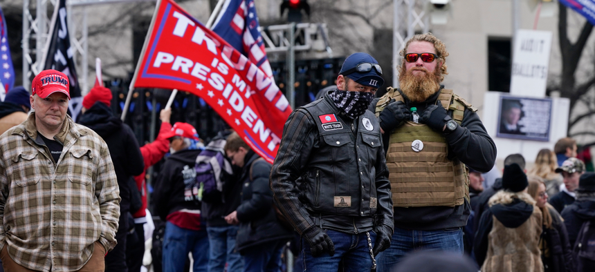 People attend a rally at Freedom Plaza Tuesday, Jan. 5, 2021, in People attend a rally at Freedom Plaza Tuesday, Jan. 5, 2021, in Washington, in support of President Donald Trump. , in support of President Donald Trump.