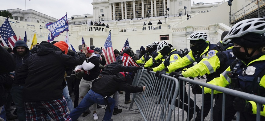 Trump supporters try to break through a police barrier on Wednesday at the Capitol.