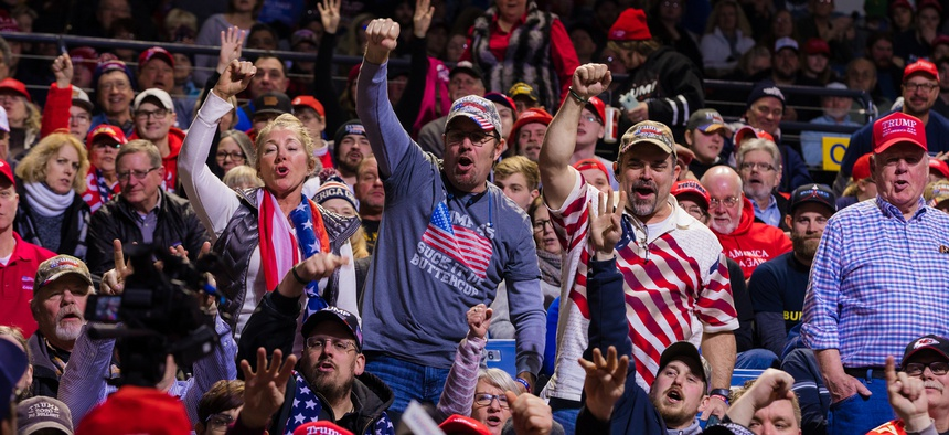 Trump supporters wait for the president's arrival at a rally in January 2020 in Iowa.
