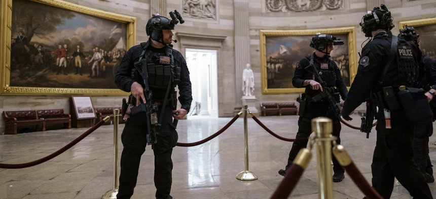 Members of the U.S. Secret Service Counter Assault Team walk through the Rotunda as they and other federal police forces responded as violent protesters loyal to President Trump stormed the U.S. Capitol on Wednesday.