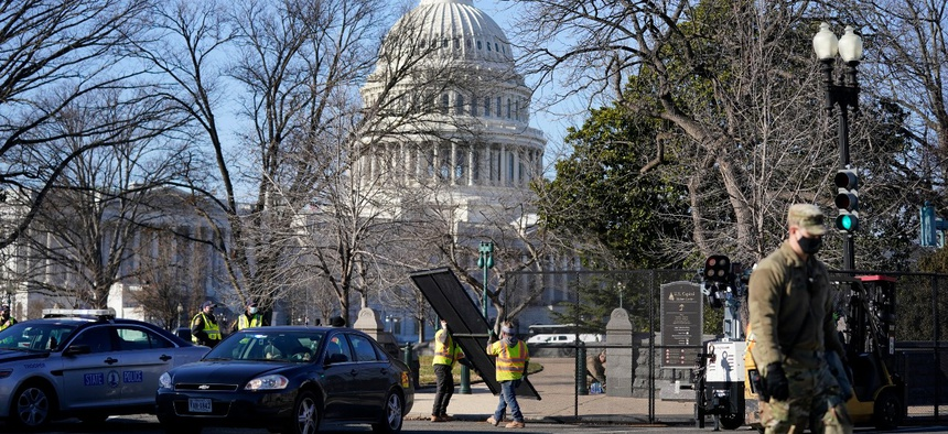 Workers install no-scale fencing around the U.S. Capitol on Jan. 7.