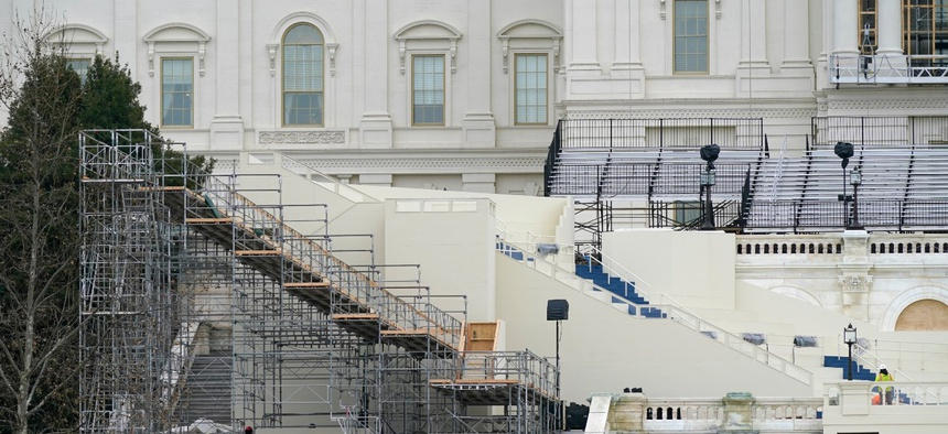 Preparations take place for President-elect Joe Biden's inauguration on the West Front of the U.S. Capitol on Jan. 8. The temporary senior executive hiring freeze will last until the inauguration on Jan. 20.