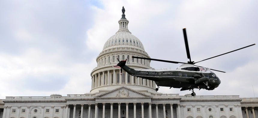 A Marine helicopter with former President George W. Bush on board departs from the East Front of the U.S. Capitol on Jan. 20, 2009.