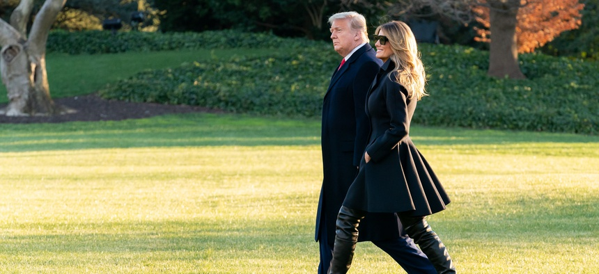 President Donald J. Trump and First Lady Melania Trump walk across the South Lawn of the White House Wednesday, Dec. 23, 2020, before boarding Marine One to begin their trip to Florida.