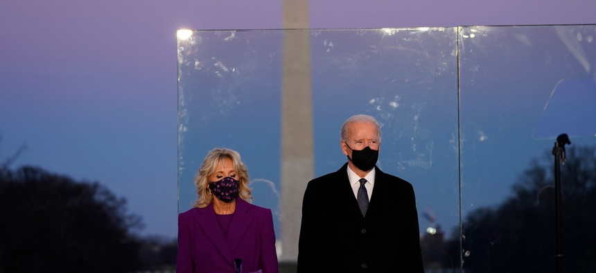 President-elect Joe Biden stands with his wife Jill Biden during a COVID-19 memorial Tuesday.