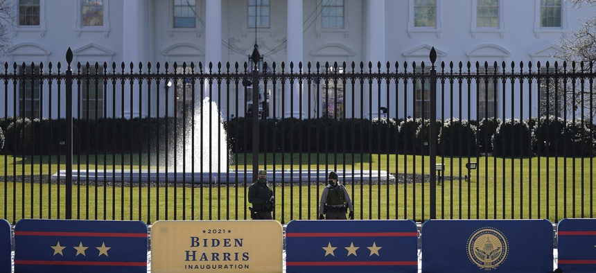 A security team patrols in front of the White House as preparations continue ahead of President-elect Joe Biden's inauguration ceremony on Tuesday.
